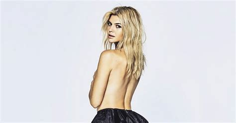 Baywatch babe Kelly Rohrbach strips off to pose topless in